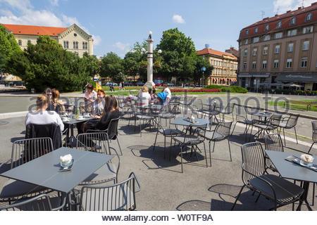 ZAGREB, CROATIA - MAY 19, 2018 : People sitting on the coffee bar terrace of Croatian National Theater in Zagreb, Croatia. - Stock Photo