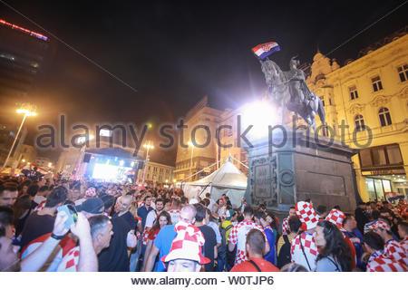 ZAGREB, CROATIA - JULY 7TH, 2018 : Croatian football fans flagged the Croatian flag on the statue of Ban Josip Jelacic on Ban Jelacic Square in Zagreb, Croatia. - Stock Photo