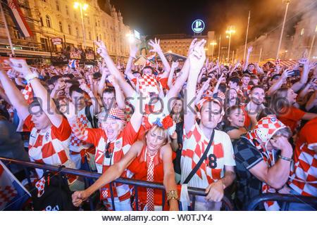 ZAGREB, CROATIA - JULY 7TH, 2018 : Croatian football fans celebrate Croatian quarter final victory over Russia on Fifa World cup 2018 on Ban Jelacic Square in Zagreb, Croatia. - Stock Photo