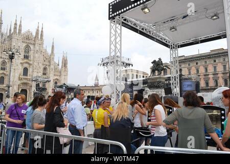 Milan, Italy - June 9, 2016:  Beauticians receiving customers for outdoors fun photo set 'Posa per Brosway' during 'Radio Italia live al concerto'. - Stock Photo