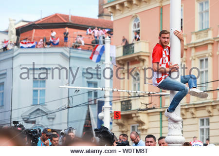 ZAGREB, CROATIA - JULY 15, 2018 : Croatian football fans support national team before and during the World Cup 2018 FIFA, Final game, France vs. Croatia on Ban Jelacic Square in Zagreb, Croatia. - Stock Photo