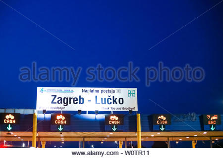 Zagreb, Croatia - August 1th, 2018 : Sign Zagreb - Lucko on the highway tollbooth Lucko at sunset in Zagreb, Croatia. - Stock Photo
