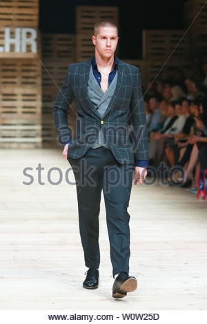 ZAGREB, CROATIA - OCTOBER 27, 2018 : Fashion model wearing clothes for autumn-winter, designed by IK Studio on the Bipa Fashion.hr fashion show in Zagreb, Croatia. - Stock Photo