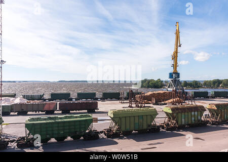 Railway station freight trains, cargo transport, timber carving wood - Stock Photo