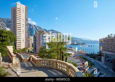 MONTE CARLO, MONACO - AUGUST 21, 2016: Buildings, mediterranean vegetation and sea view in a sunny summer day in Monte Carlo, Monaco. - Stock Photo