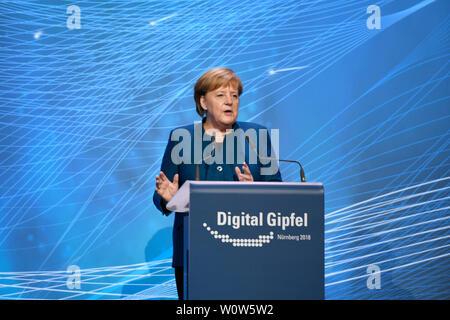 Die deutsche Bundeskanzlerin Dr. Angela Merkel bei Ihrer Rede auf dem Digital Gipfel Digital Gipfel 2018 der Bundesregierung am 04.12.2018 im Congress Center der Messe Nuernberg