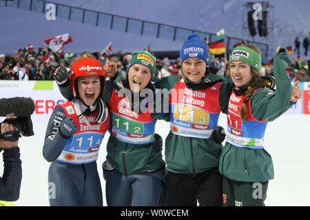 Die historischen Weltmeisterinnen: v.li. Katharina Althaus (SC Oberstdorf), Ramona Straub (SC Langenordnach), Carina Vogt (SC Degenfeld), Juliane Seyfarth (TSG Ruhla) im Auslauf der Schanze nach dem Teamspringen Frauen, FIS Nordische Ski-WM 2019 in Seefeld - Stock Photo