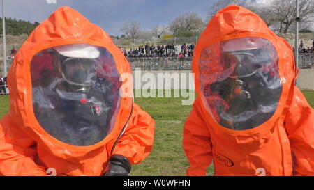 Firefighters from Northern Israel with protective gear seal leak of of Bromine chemical during simulation drill. CAABIYA, ISRAEL, FEBRUARY 10, 2016: - Stock Photo