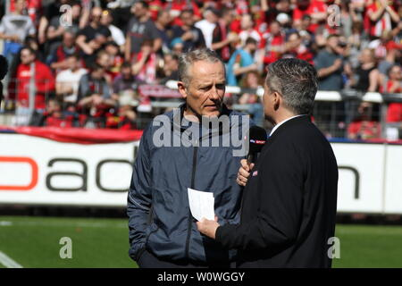 Trainer Christian Streich (Freiburg) im Interview mit SKY-Reporter,   1. BL: 18-19: 27. Sptg. -  SC Freiburg vs. FC Bayern München  DFL REGULATIONS PROHIBIT ANY USE OF PHOTOGRAPHS AS IMAGE SEQUENCES AND/OR QUASI-VIDEO  Foto: Joachim Hahne/johapress - Stock Photo