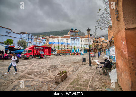 Chefchaouen, Morocco - May 4, 2019: Daily activity in the square called 'Outa El Hammam', located in the historic center of the city of Chefchaouen, i - Stock Photo