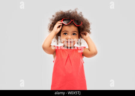 african ameican girl with heart shaped sunglasses - Stock Photo
