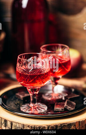 Homemade red currant nalivka and chocolate on metal tray - Stock Photo