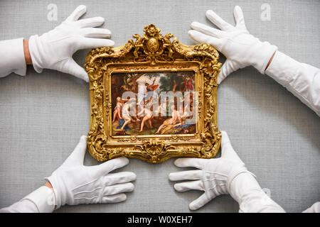 London, UK.  28 June 2019. Technicians present 'Diana and Actaeon' by Joachim Antonisz Wtewael (Est. GBP4-6m) at the preview of Sotheby's Old Masters sale which takes place at its New Bond Street galleries on 3 July.  Credit: Stephen Chung / Alamy Live News - Stock Photo