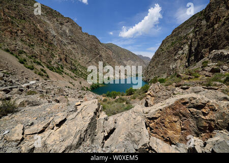 Fan Mountains in Tajikistan are one of Central Asia is premier trekking destination. The beautiful seven lake trek from Penjikent. View on the lake nu - Stock Photo