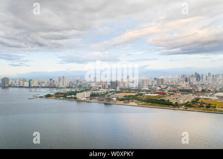 Manila city in the morning, view from above. Panorama of a large port city. City with modern buildings and skyscrapers. Manila, the capital of the Philippines. Asian metropolis. - Stock Photo