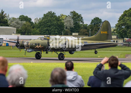 Sally B, the preserved Boeing B-17 Flying Fortress bomber taking off for the last Wings & Wheels Airshow held at Dunsfold Aerodrome, UK on 16/6/19. - Stock Photo