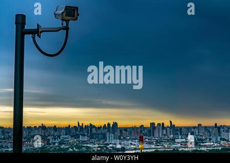 bangkok,Thailand - jun 26, 2019 :  CCTV monitoring, security cameras. Backdrop with views of the city during beautiful  twilight. - Stock Photo