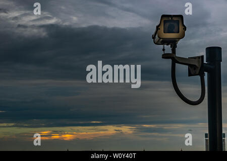 bangkok,Thailand - jun 26, 2019 :  CCTV monitoring, security cameras. Backdrop with sky and clouds during beautiful  twilight. - Stock Photo