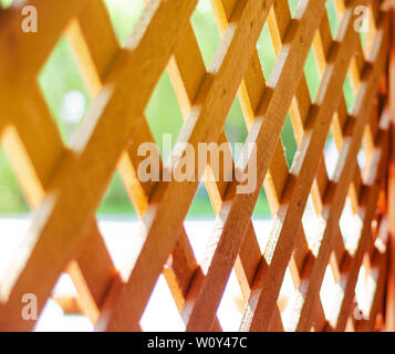 Wooden lattice wall in cafe. - Stock Photo
