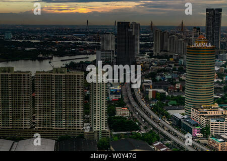 bangkok,Thailand - jun 26, 2019 : The skyscrapers of Bangkok along the Chao Phraya River in the evening give the city a modern style. - Stock Photo