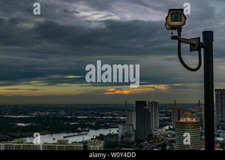 bangkok,Thailand - jun 26, 2019 :  CCTV monitoring, security cameras. Backdrop with views of the city and Chao Phraya River in the evening. - Stock Photo