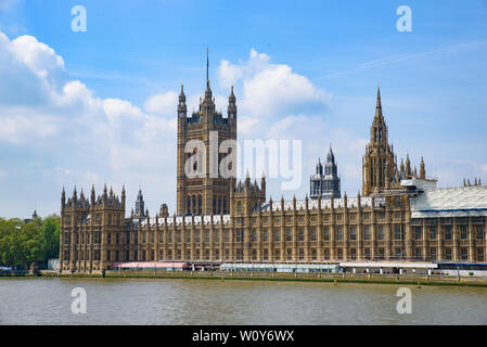The Palace of Westminster as the Houses of Parliament on the north bank of the River Thames in London, United Kingdom - Stock Photo