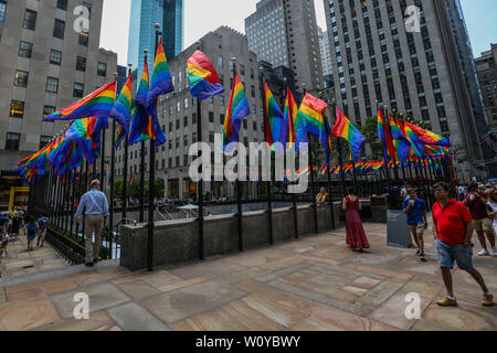 June 28, 2019 - New York, New York, United States - Rainbow flags are seen at Rockefeller Plaza to celebrate International LGBT Pride Day in New York in the United States this Friday, 28. (Credit Image: © William Volcov/ZUMA Wire) - Stock Photo