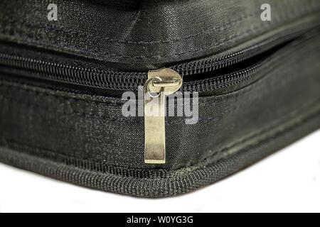 Zipper case. Black closed zipper case isolated on white background - Stock Photo