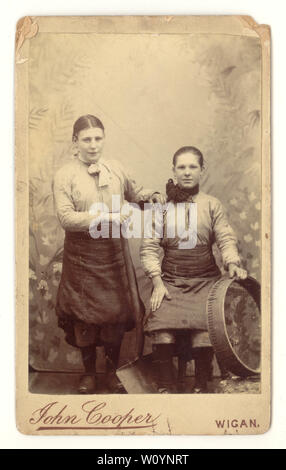 Original Victorian CDV (Carte de Visite) portrait of pit brow girls (broo lasses or wenches) posing with the tools of their trade - a shovel and sieve. They worked on the pit bank (or brow) at the shaft top picking stones out of the coal, on the coalfield, photographed by John Cooper's studio, Wigan, Greater Manchester, Lancashire, U.K. circa 1870