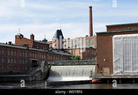 Tampere Finland 06/12/2019  Tammerkoski (rapids in Tampere) flowing in the area of  Tampella and Finlayson - Stock Photo