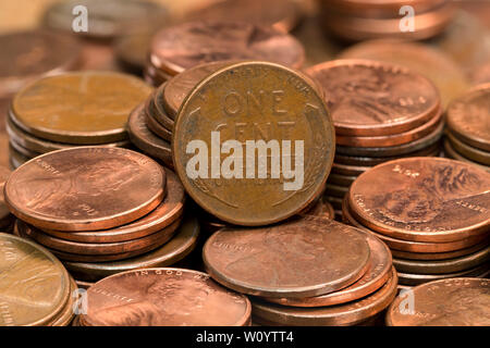 stacked coins, pennies, lined up in rows - Stock Photo