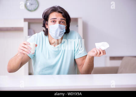 Young man suffering from allergy - Stock Photo