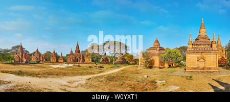 Panorama with small ancient brick shrines of Bagan archaeological site, stretching along savannah, Myanmar - Stock Photo