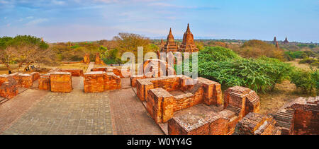Observe the evening panorama of Bagan with greenery of savannah and ruins of ancient Somingyi monastery, Myanmar - Stock Photo