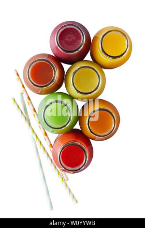 Several isolated glass jars without caps filled with different colors of blended juices on white surface - Stock Photo