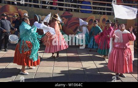 Cholitas dancing in El Alto, La Paz, Bolivia - Stock Photo