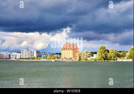 Dramatic clouds over the lake and the city of Schwerin. Mecklenburg-Vorpommern, Germany - Stock Photo
