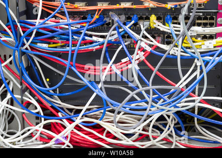 Bangkok Thailand :- June 25, 2019 :-  cable network in server room cable tangled of poorly routed cables Concept Organized Cabling in server rooms - Stock Photo