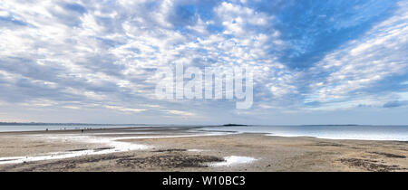 Beach leading out to Kings Island at low tide - Stock Photo