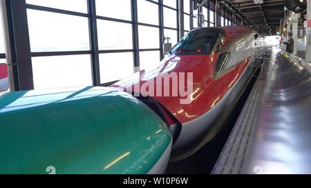 Shinkansen Hayabusa and Komachi combination and separation at JR Morioka Station - Stock Photo