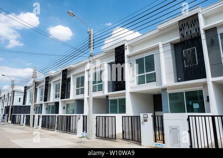Bangkok, Thailand - June 30 2018 : Village project for sale of modern white townhouse 2 floors with fence in Bang Yai - Stock Photo