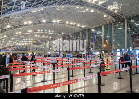 Chengdu, China - Oct 21 2018 : Airport structure with steel is decorated with lights and organizing of passengers - Stock Photo