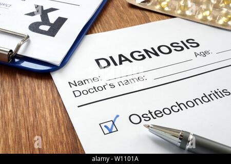 Diagnosis osteochondritis and prescription form on desk. - Stock Photo