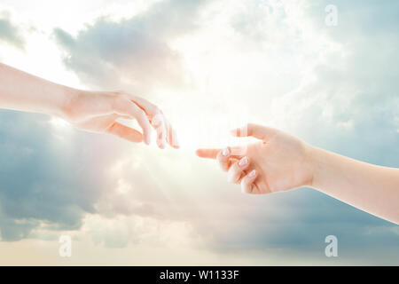 Hands and heaven. Helping, giving and taking hand