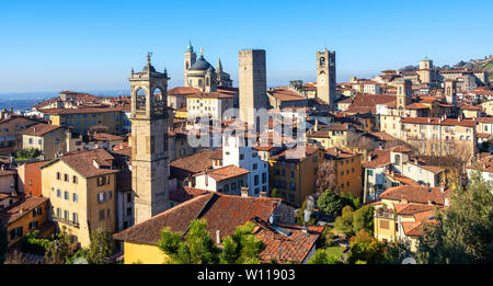 Bergamo, panoramic view over the red tile roofs and towers of medieval historical Old Town, Lombardy, Italy - Stock Photo