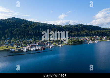 Aerial view of the pier in the Teletskoye lake with ships, ships and boats moored to the coast near the village of Artybash on a sunny summer day. Res - Stock Photo