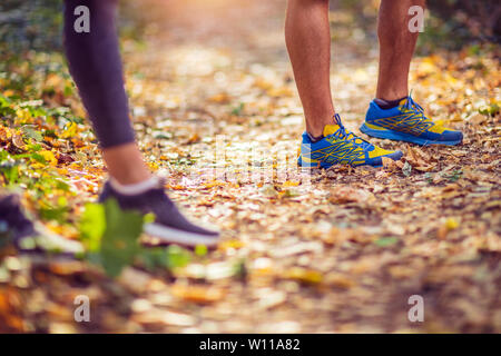 Running sport fitness man. Close up of male legs and shoes. Young Man athlete fitness runner running shoes. Trail running concept.