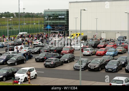 Waterford, Ireland. 28 June 2019. Irish citizenship ceremony. General view of WIT Arena Waterford with people leaving the building after attending the ceremony and having their papers as new Irish citizens. Waterford has been chosen this year for a smaller ceremony in order for the event to coincide with the annual celebration of the first hoisting of the tricolour by Thomas Francis Meagher in Waterford in 1848. - Stock Photo