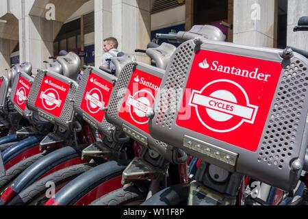 A row of Santander Boris Bikes parked in High Holborn, London, UK - Stock Photo