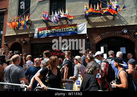 People gather for an event marking the 50th anniversary of the Stonewall Inn uprising in New York on June 28, 2019. - Stock Photo